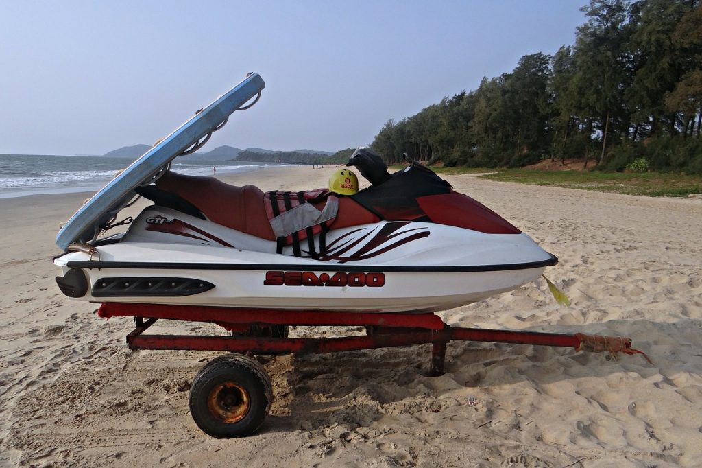 jet ski rental with board on back at beach