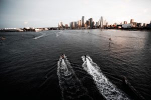 Shoreline view when Friend on Phone who Renting a Boat from Miami Beach