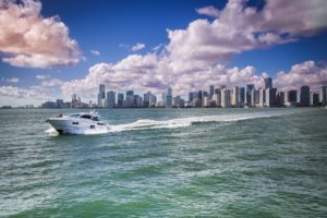 Photo of yacht rental and shoreline of miami beach